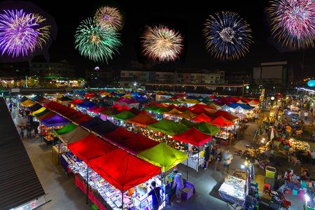 Bird eyes view of Multi-colored tents Sales of second-hand market with new year firework at night.