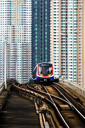 BTS Sky train in Bangkok with building