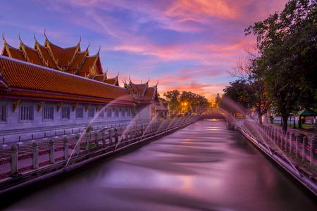 Beautiful Thai Marble Temple (Wat Benchamabophit) during twilight sunset time in Bangkok, Thailand.