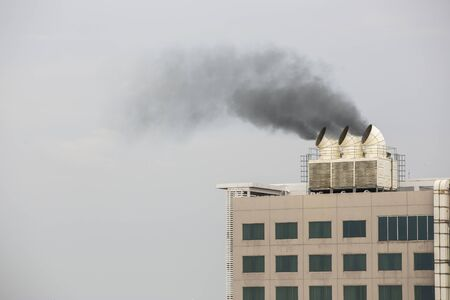Air duct and ventilation system of factory with thick smoke from pipe emissions pollution into the atmosphere.