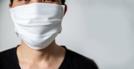 A man wear breathing medical respiratory mask against the Coronavirus (CoVID-19) isolated on white background.