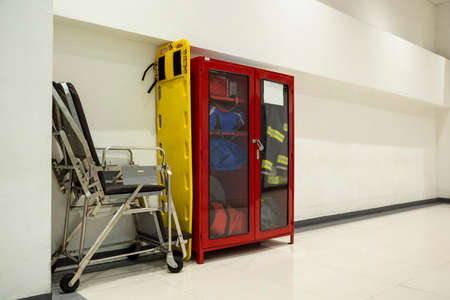 Wall Hanging Fire Extinguisher, Fire Safety, stretchers and Emergency Equipment install in Red Box wall mount architectural fire extinguisher glass cabinet in Industrial building.