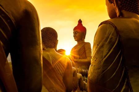 pay buddha in temple and beautiful sunset