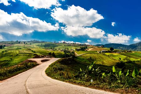 road sign highway sign: nature with road on hill  and sunny day Stock Photo