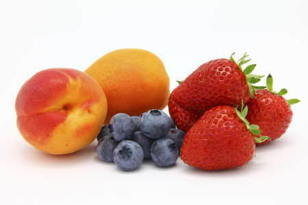 Apricots, Blueberries and Strawberries - Seasonal Fruits Imagens