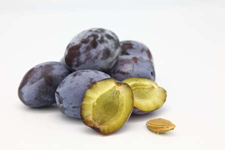 Blue Plums with a sliced plum Imagens