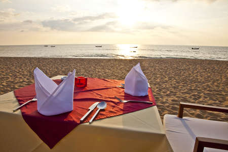 table linen: A Table is ready for Dinner at the Beach Stock Photo