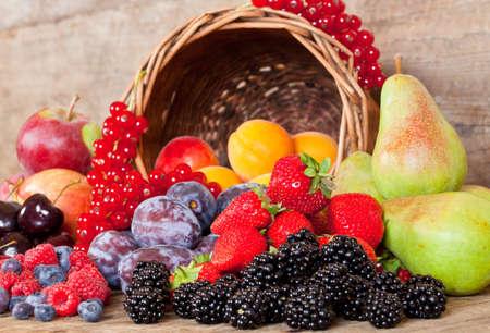 Freshly harvested seasonal Fruits, with a Basket