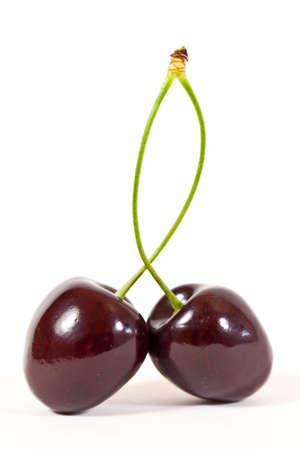 Two big, sweet Cherries isolated in Studio