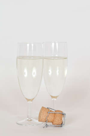 Two Glasses of Champagne with a cork