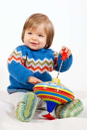 A young Kid is Playing with a Toy in Studio.