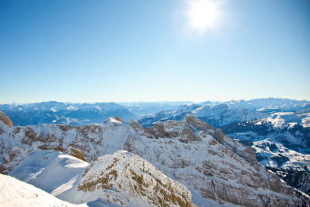 The Sun is shining in the Alps. Nice Winter Mountains. Imagens