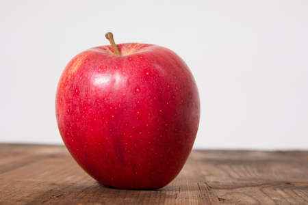 Red Gala Apple on a wooden Plate, captured in Studio