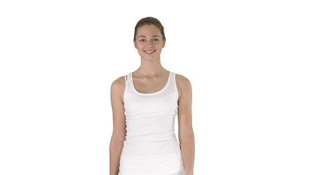 Young woman walking on white background. Фото со стока