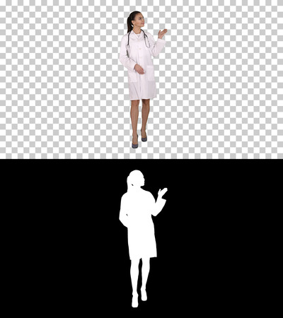 Young medical doctor woman presenting and showing product or text, Alpha Channel Stockfoto