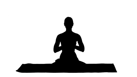 Silhouette Smiling woman yoga meditating sitting lotus, hands coupled.