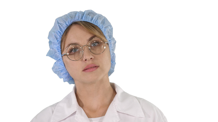 Medical doctor woman going on white background.