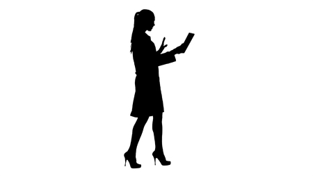 Silhouette Young woman doctor holding tablet in her hands and making video call.