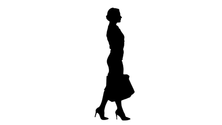 Silhouette Happy full length woman holding paper shopping bags in every hand and walking.