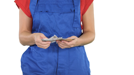 Concept of making money in the construction building trade, a woman counting money on white background.