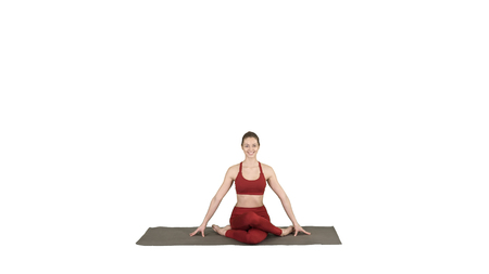 Young attractive woman practicing yoga, sitting in Gomukasana exercise, Cow Face pose on white background. Reklamní fotografie - 120867583