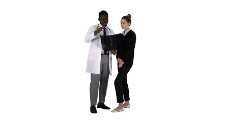 Young woman visiting radiologist for x-ray exam of her brain on white background.