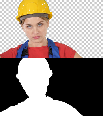 Proud confident young woman worker with arms on hips, Alpha Channel Imagens