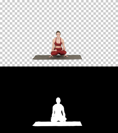Young sporty woman practicing yoga, doing Scale exercise, Tolasana pose, Alpha Channel