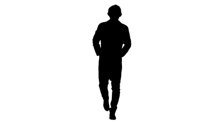 Silhouette Walking young male doctor wearing surgical mask. Reklamní fotografie