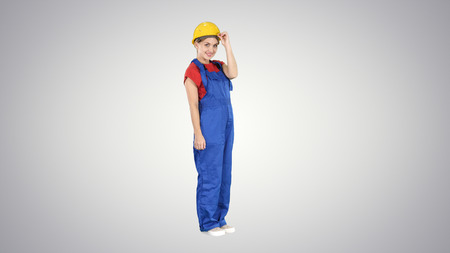 Confident construction worker greet Say hello on gradient background. Stock Photo