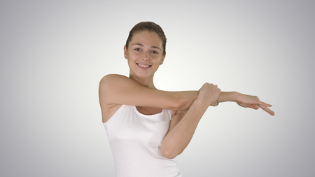 Woman happy smiling woman stretching arms while walking on gradient background.