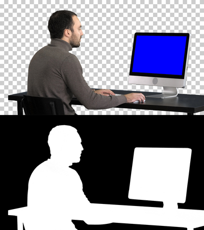 Businessman working with a computer, Alpha Channel. Blue Screen Mock-up Display.