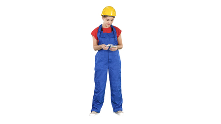 Construction woman counts money and happy after work is done on white background.