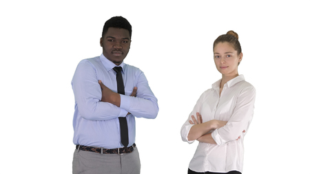 International business people standing with folded arms on white background.