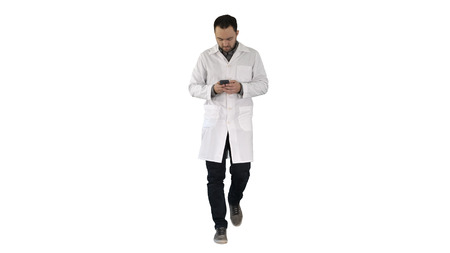 Doctor walking and writing a message on the phone on white background.
