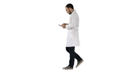 Medical care and healthcare Doctor use tablet checking on white background. Stockfoto
