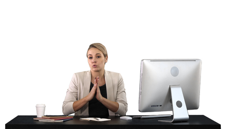 Cute businesswoman looks at the camera in her office and talks, white background