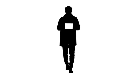 Full length shot. Silhouette Attractive man holding tablet with white key screen mockup. Professional shot in 4K resolution. 006. You can use it e.g. in your commercial video, business, presentation, broadcast
