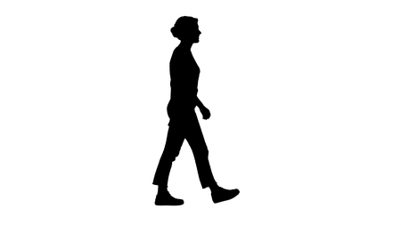 Full length shot. Side view. Silhouette Woman in red t-shirt, jeans and sneakers walking. Professional shot in 4K resolution. 006. You can use it e.g. in your commercial video, business, presentation, broadcast Stockfoto