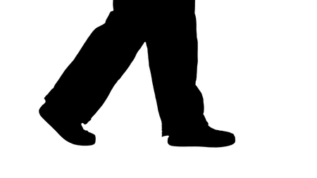 Close up on legs. Side view. Silhouette Legs of woman construction worker walking. Professional shot in 4K resolution. 006. You can use it e.g. in your commercial video, business, presentation, broadcast