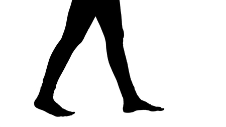 Medium shot. Side view. Silhouette Womans legs are bare and taking steps. Yoga. Professional shot in 4K resolution. 009. You can use it e.g. in your sport, yoga, healthy, commercial video, business, presentation, broadcast