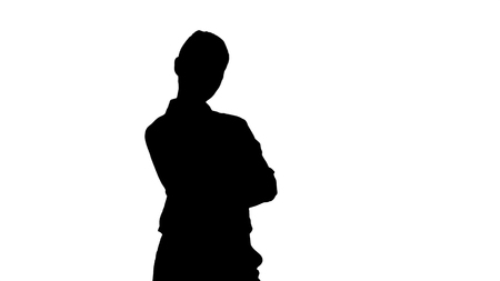 Medium shot. Silhouette Thoughtful woman with crossed hands. Professional shot in 4K resolution. 009. You can use it e.g. in your sport, yoga, healthy, commercial video, business, presentation, broadcast Stockfoto