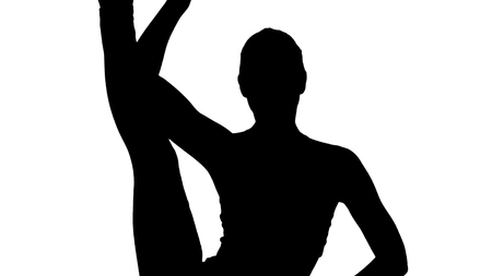 Close up. Silhouette Beautiful young woman Standing split-urdhva prasarita Eka padasana. Professional shot in 4K resolution. 009. You can use it e.g. in your sport, yoga, healthy, commercial video, business, presentation, broadcast