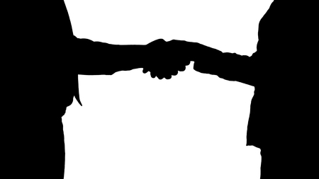 Close up. Silhouette Hands of businessman and businesswoman handshaking. Professional shot in 4K resolution. 012. You can use it e.g. in your commercial video, medical, business, presentation, broadcast
