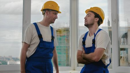 Construction workers having a talk.