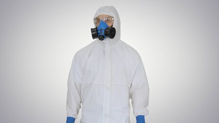 Virologist Man in Protective Costume checking the situation on gradient background.