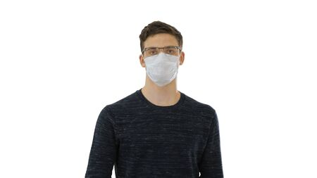Student in antiviral mask walking on white background.