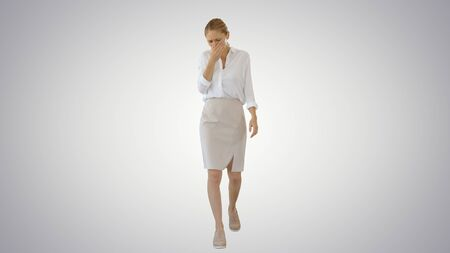 Wide shot. Young Business Woman walking feeling Sick and Coughing on gradient background. Professional shot in 4K resolution. 53. You can use it e.g. in your medical, commercial video, business, presentation, broadcast