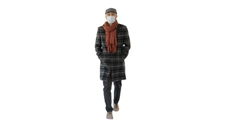 Wide shot. Gentleman with medical face mask walking on white background. Professional shot in 4K resolution. 53. You can use it e.g. in your medical, commercial video, business, presentation, broadcast