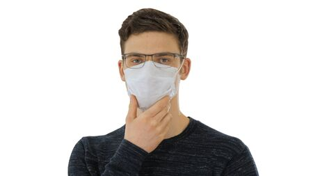 Close up. Man in a disposable mask and glasses on white background. Professional shot in 4K resolution. 53. You can use it e.g. in your medical, commercial video, business, presentation, broadcast